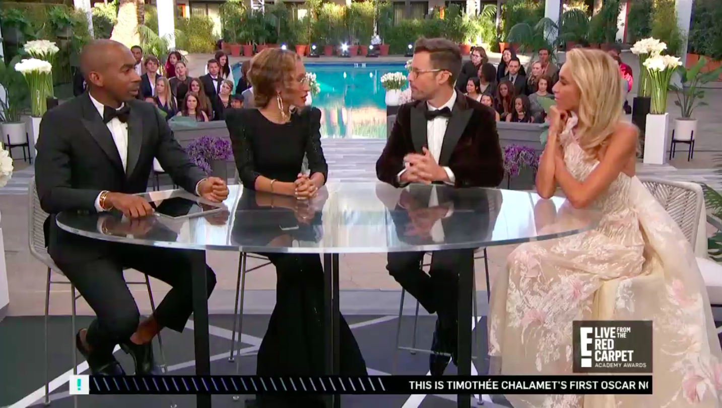 Four panelists for E! discuss the red carpet.