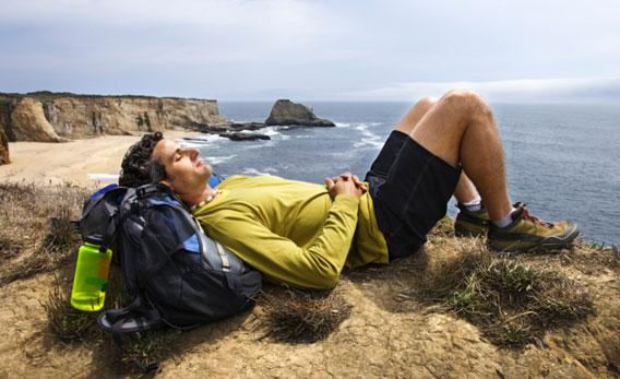 Hiker resting outdoors.