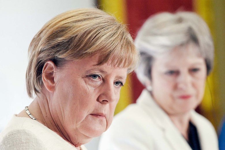 German chancellor Angela Merkel and U.K. Prime Minister Theresa May are seen during a press conference at Lancaster House on Tuesday in London.