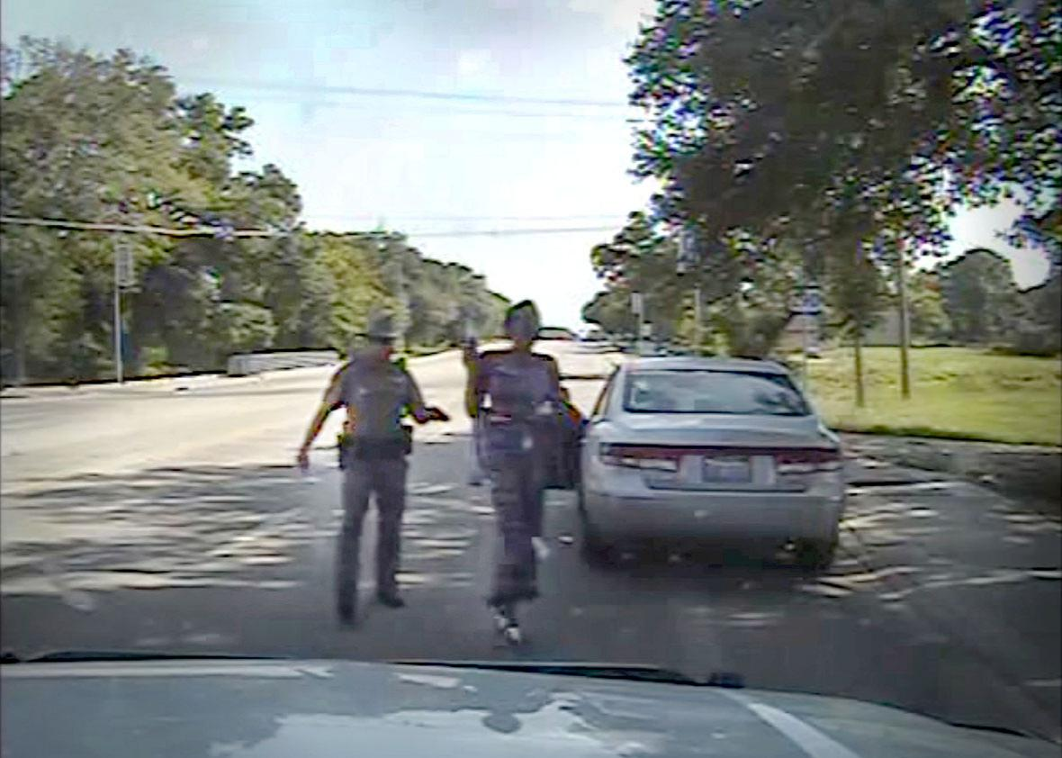 Trooper Brian Encinia points a stun gun at Sandra Bland as he orders her out of her vehicle, in this still image captured from the police dashboard camera video from the traffic stop of Bland's vehicle in Prairie View, Texas, on July 10, 2015