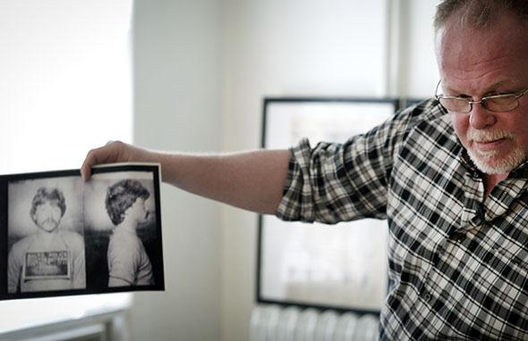 Kirk Bloodsworth shows pictures of the convicted murderer Kimberly Shay Ruffner during an AFP interview in his apartment in Mount Rainier, Maryland, on Sept. 26, 2012. Bloodsworth was the first American sentenced to death row who was exonerated by DNA fingerprinting