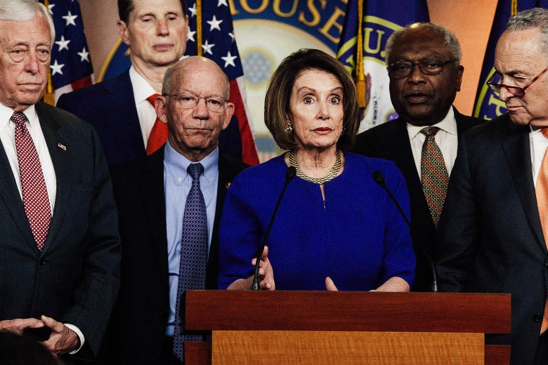 Speaker of the House Rep. Nancy Pelosi (center) speaks to the media as Senate Minority Leader Sen. Chuck Schumer and other congressional leaders listen on May 22 in Washington.