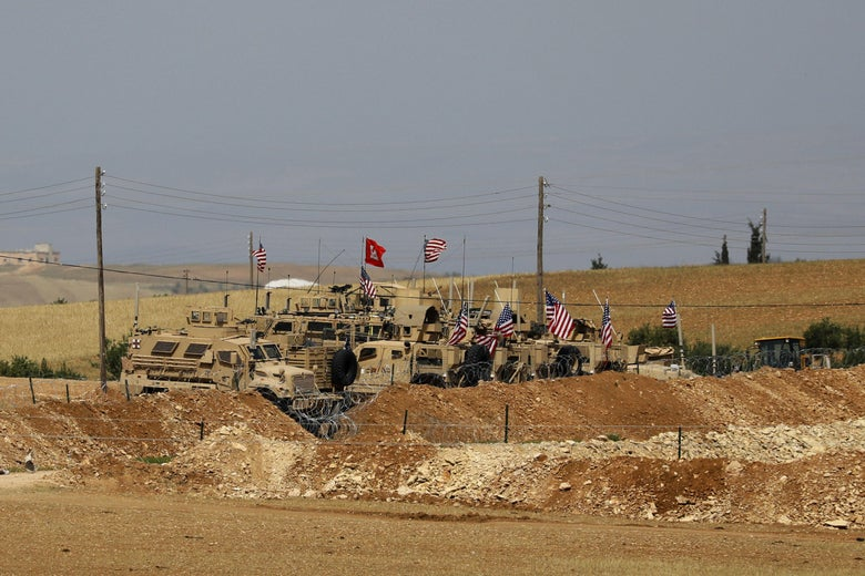 Vehicles of the U.S.-backed coalition forces in the northern Syrian town of Manbij
