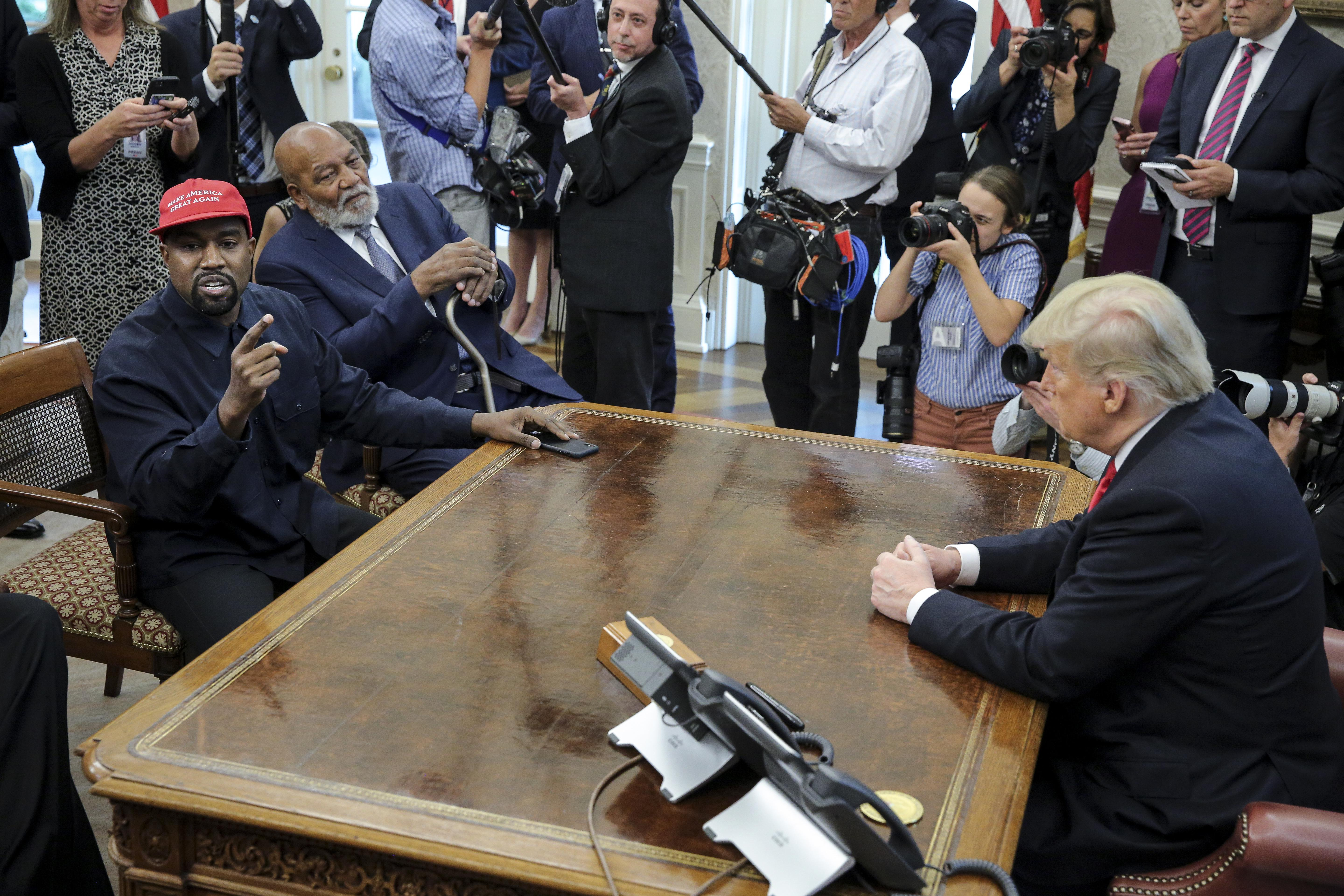 Kanye West and Donald Trump in the Oval Office.