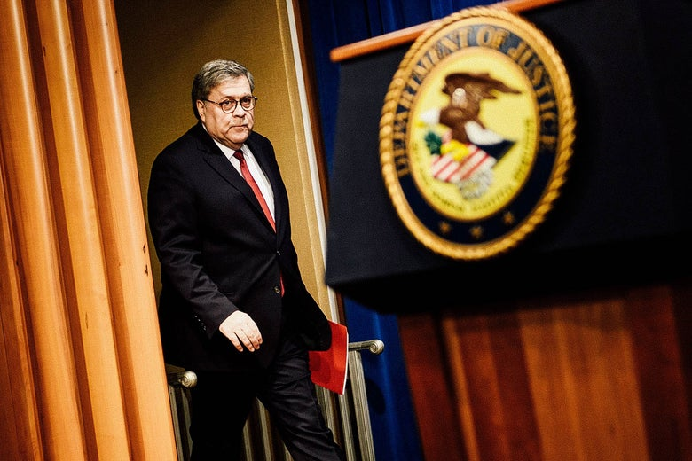 William Barr walks toward a DOJ podium