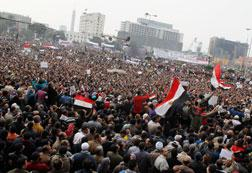 Thousands chant anti-government slogans during a massive rally in Tahrir Square. Click image to expand.