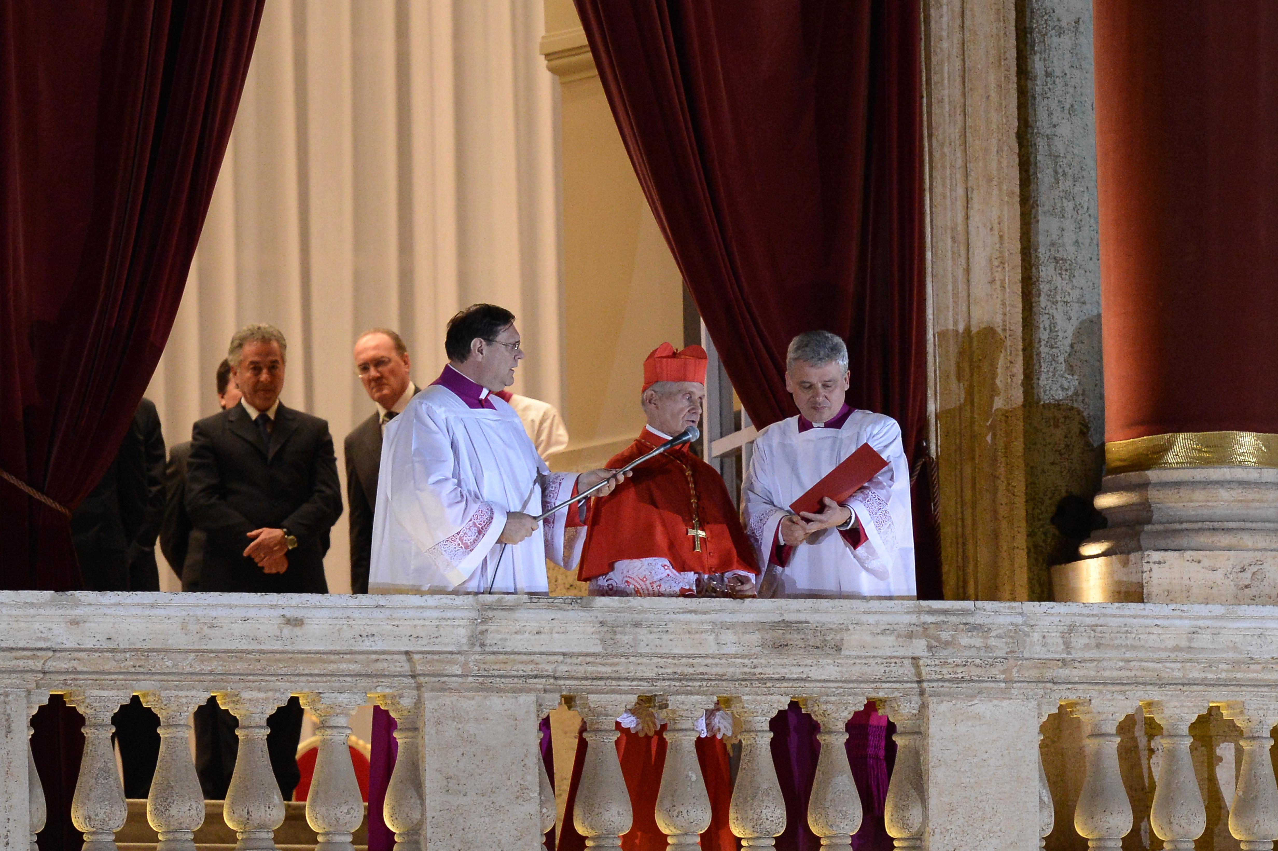 French proto-deacon cardinal Jean-Louis Tauran (center) announces the name of the new pope, Argentinian cardinal Jorge Mario Bergoglio on March 13, 2013, from the balcony of St Peter's basilica at the Vatican.