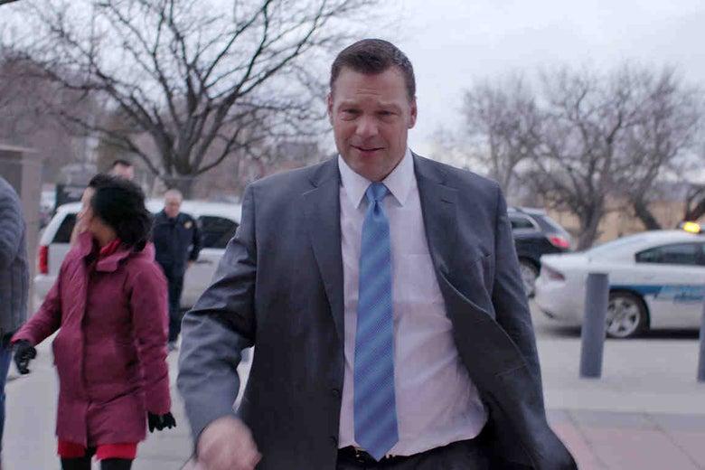 Kansas Secretary of State Kris Kobach walks into a courtroom.