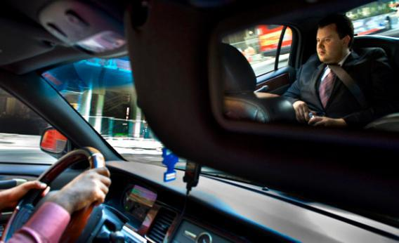 Brendan Kownacki rides in the Uber Car that he beckoned via a smartphone app in Washington, DC on July 16, 2012.
