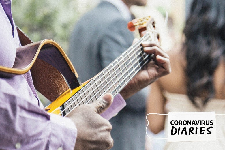 """A person is seen playing guitar behind a couple in wedding outfits. A mask with the words """"Coronavirus Diaries"""" is seen on the bottom right."""