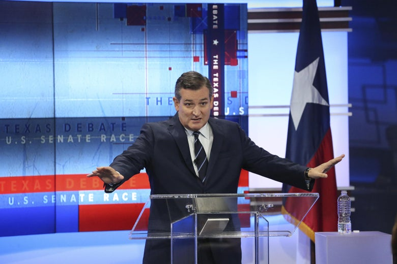 Ted Cruz stands behind a clear podium.
