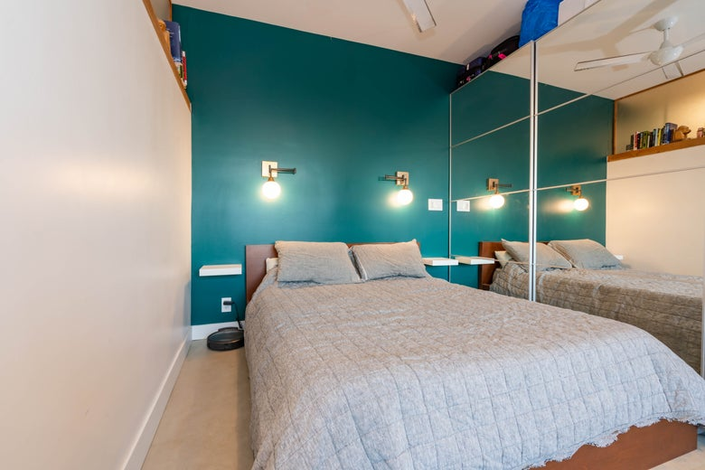 """The """"bedroom"""" of the restored burned-down shack."""