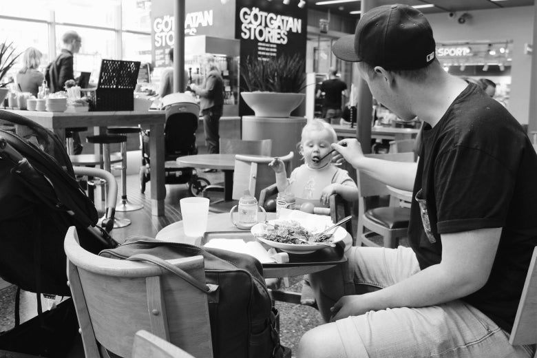 A father enjoying an afternoon lunch with his child at a shopping mall in Södermalm.