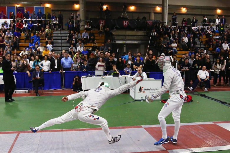 CAMBRIDGE, MA - DECEMBER 13:  Eli Dershwitz of the United States, right, and Junghwan Kim of Korea compete in a bout during the 2015 Fencing Grand Prix Boston at : Harvard University Gordon Indoor Track on December 13, 2015 in Cambridge, Massachusetts.  (Photo by Maddie Meyer/Getty Images)