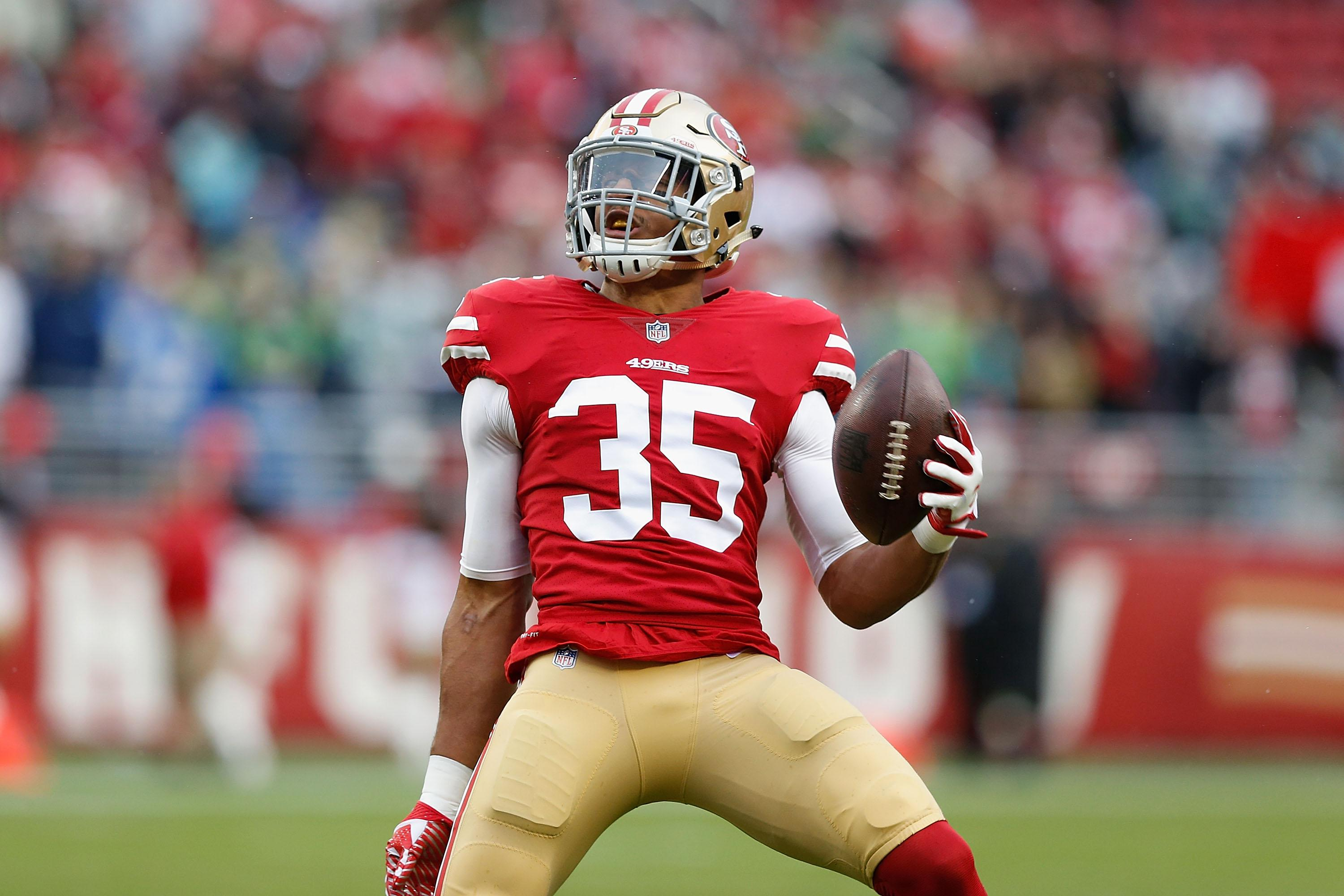 SANTA CLARA, CA - NOVEMBER 26: Eric Reid #35 celebrates after intercepting a pass against the Seattle Seahawks at Levi's Stadium on November 26, 2017 in Santa Clara, California. (Photo by Lachlan Cunningham/Getty Images)