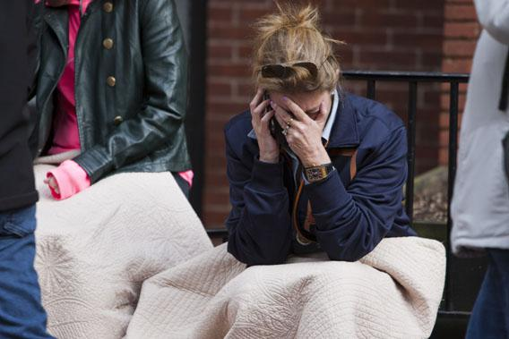A woman talks on the phone after two explosions interrupted the running of the Boston Marathon in Boston, Massachusetts April 15, 2013.