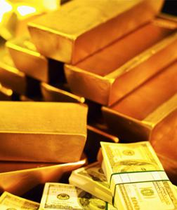 Gold bars and bank notes. Click image to expand.