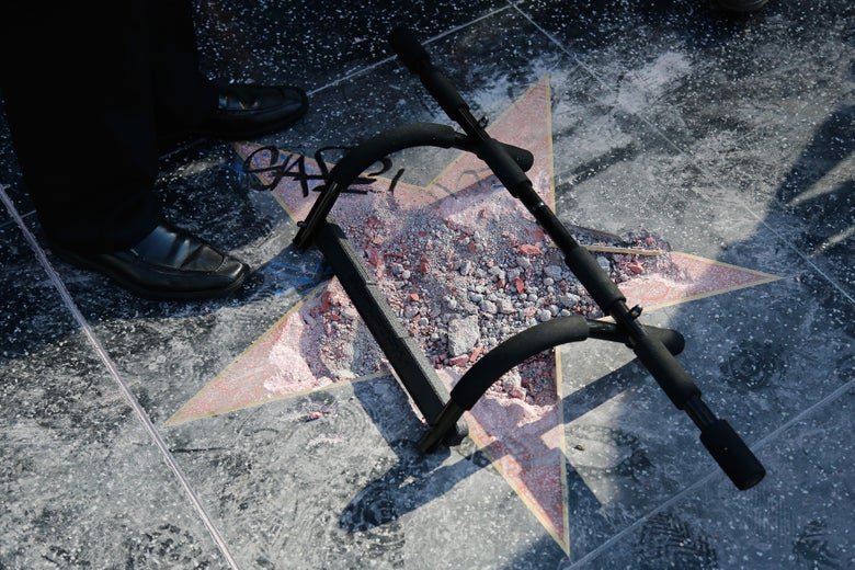 Donald Trump's star reduced to rubble, with a pull-up bar over it.