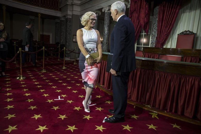 Arizona Sen. Kyrsten Sinema participates in a mock swearing-in ceremony with Vice President Mike Pence on Jan. 3 in Washington, D.C.