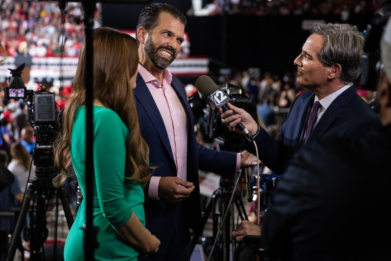 Kimberly Ann Guilfoyle and Donald Trump, Jr. speak with reporter Brahm Resnik at a rally at the Arizona Veterans Memorial Coliseum on February 19, 2020 in Phoenix, Arizona.
