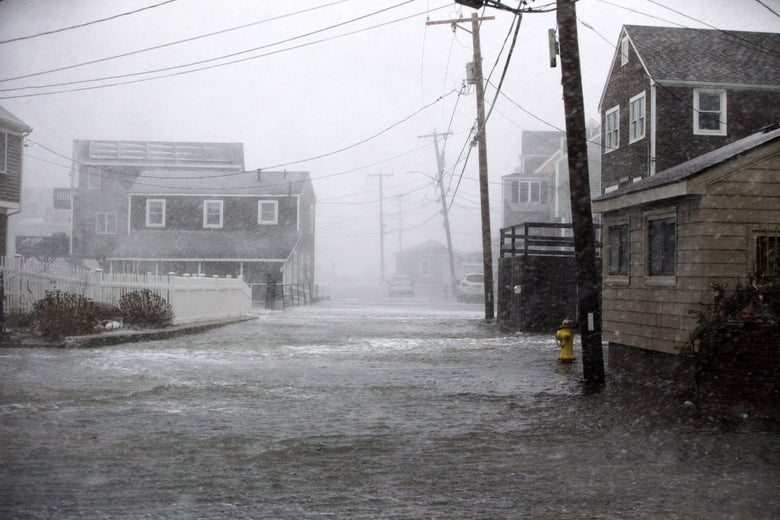 SCITUATE, MA - JANUARY 04: Lighthouse Rd. begins to flood as a massive winter storm begins to bear down on the region on January 4, 2018 in Scituate, Massachusetts. The 'bomb cyclone' was expected to dump heavy snows in New England as the storm system moved up the U.S. east coast.  (Photo by Scott Eisen/Getty Images)