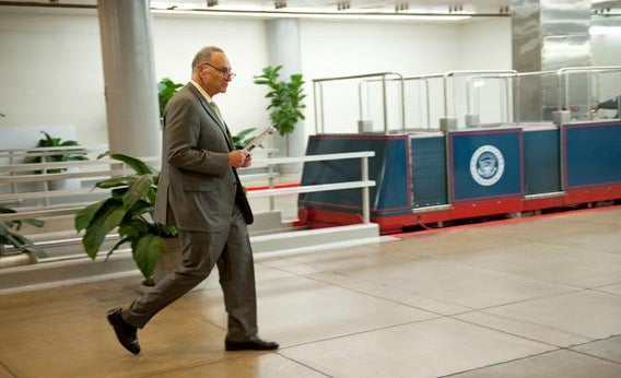 Sen. Charles Schumer, D-NY., make his way from the U.S. Capitol to the Senate Subway on April 10, 2013.