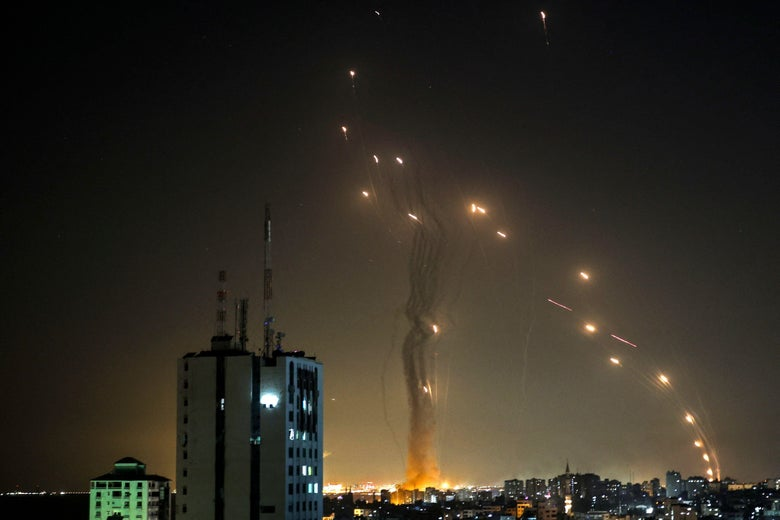 Explosions in an arc across the night sky over Gaza.