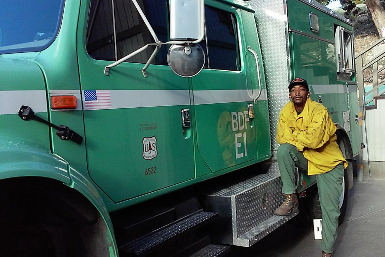 Brandon Smith standing next to a U.S. Forest Service truck.