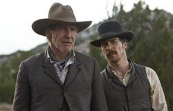 """Still of Harrison Ford and Sam Rockwell in """"Cowboys & Aliens."""" Click image to expand."""