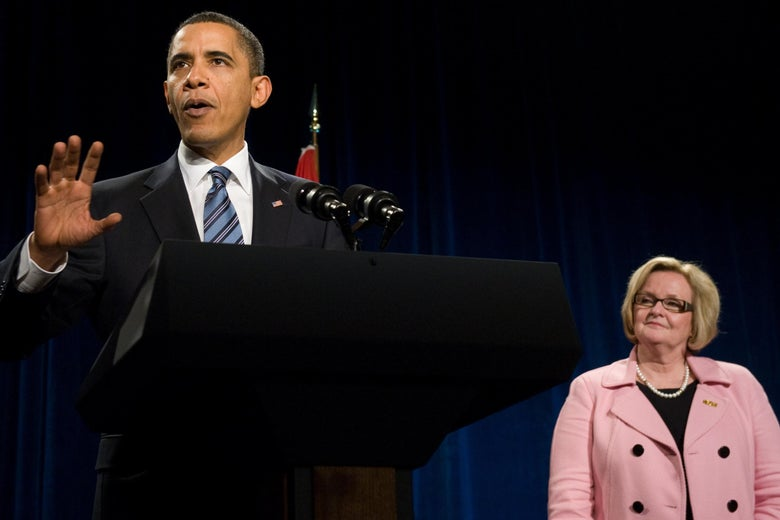 President Barack Obama speaks at a podium with Claire McCaskill to the right.