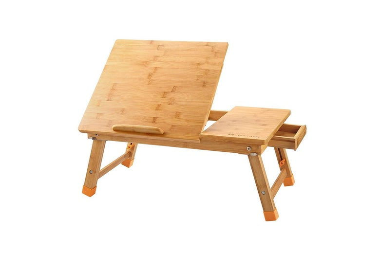 A wooden laptop desk where part of the surface lifts up.