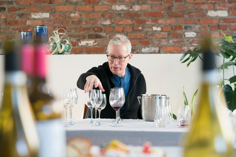 New York Times wine critic Eric Asimov checking out glasses.