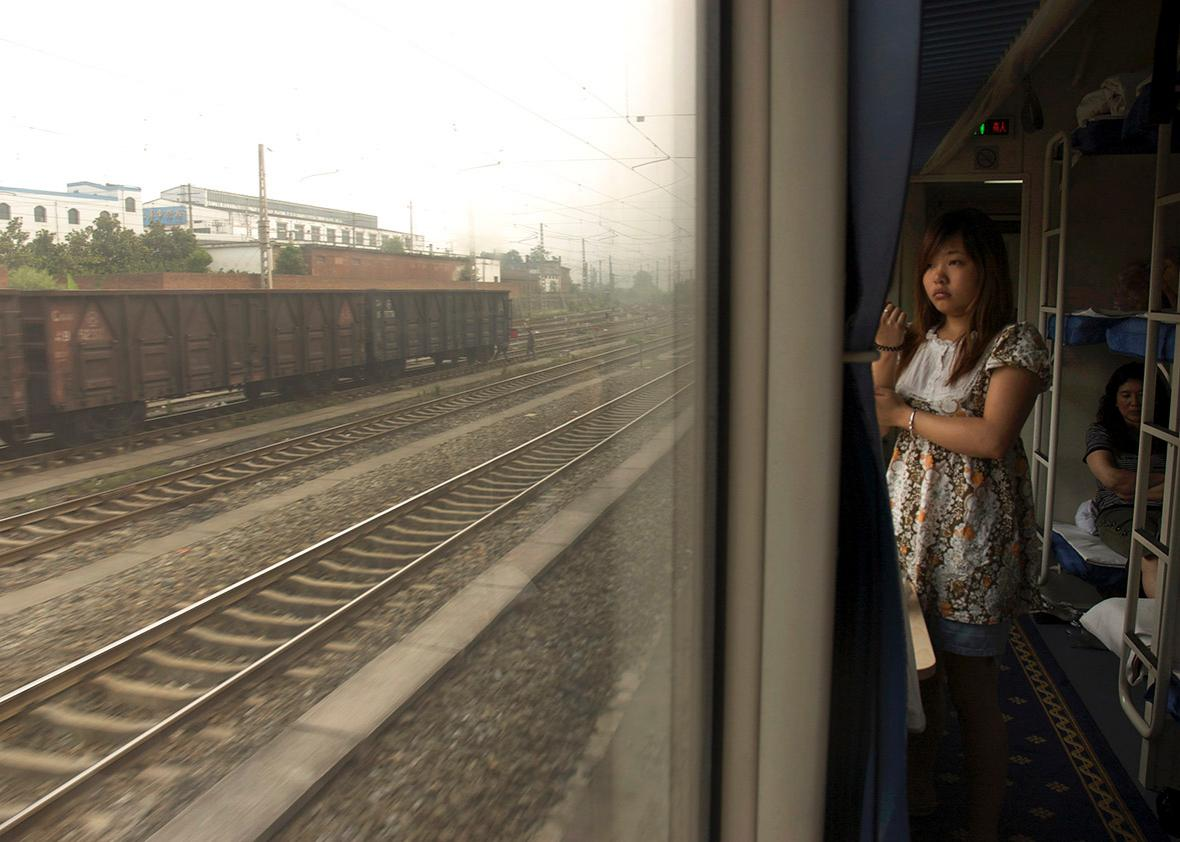 A passenger on a train from Beijing to Chengdu looks out the win