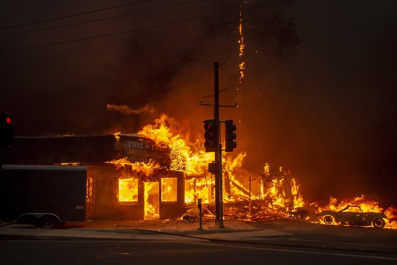 A store in flames at night