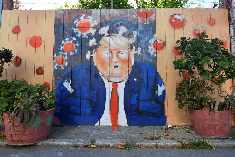 A mural painted on a fence depicts President Donald Trump as the coronavirus.