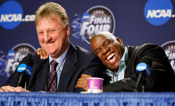 Larry Bird and Earvin 'Magic' Johnson embrace.