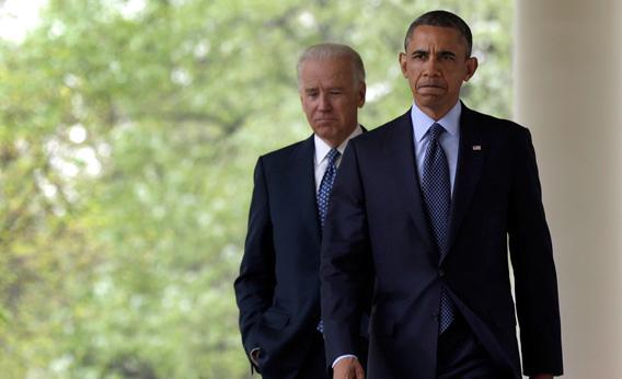 President Barack Obama (R) walks with U.S. Vice President Joe Biden before making a statement on gun violence in the Rose Garden of the White House on April 17, 2013 in Washington, DC.