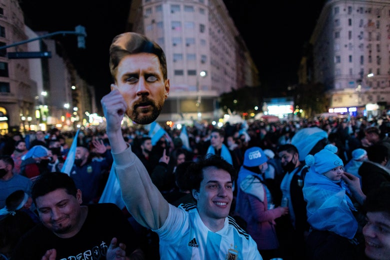 An Argentine fan holds a picture of Lionel Messi as fans gather to celebrate at the Obelisk after their team won the Copa America final against Brazil on July 10, 2021 in Buenos Aires, Argentina.