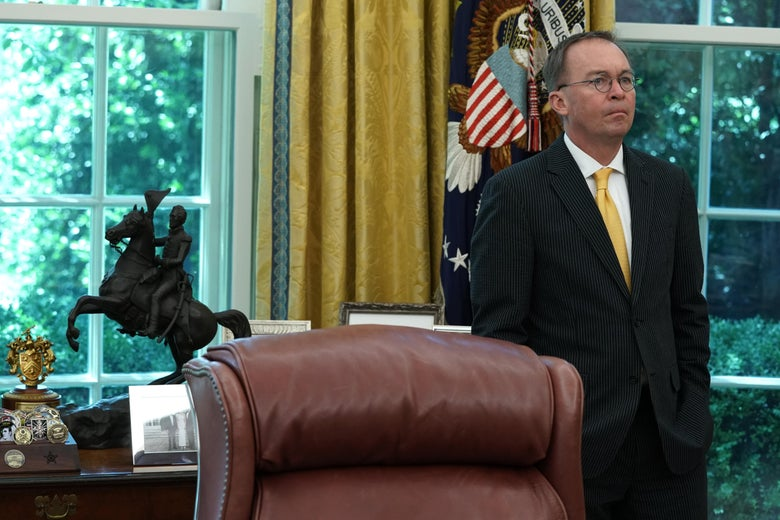 Acting White House Chief of Staff Mick Mulvaney listens during a meeting between President Donald Trump and Qatari Emir Sheikh Tamim bin Hamad Al Thani in the Oval Office at the White House July 9, 2019 in Washington, D.C.