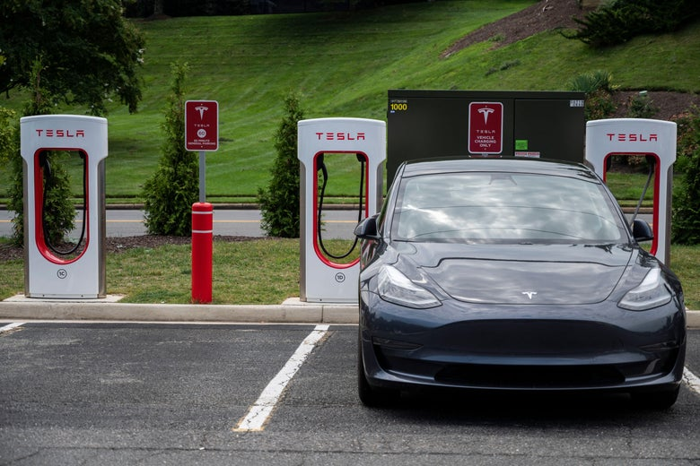 Cars charge at a Tesla super charging station.