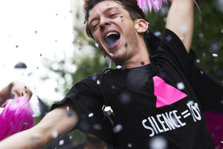 In a still from BPM (Beats per Minute), a character rejoices with pink pompoms during a parade.