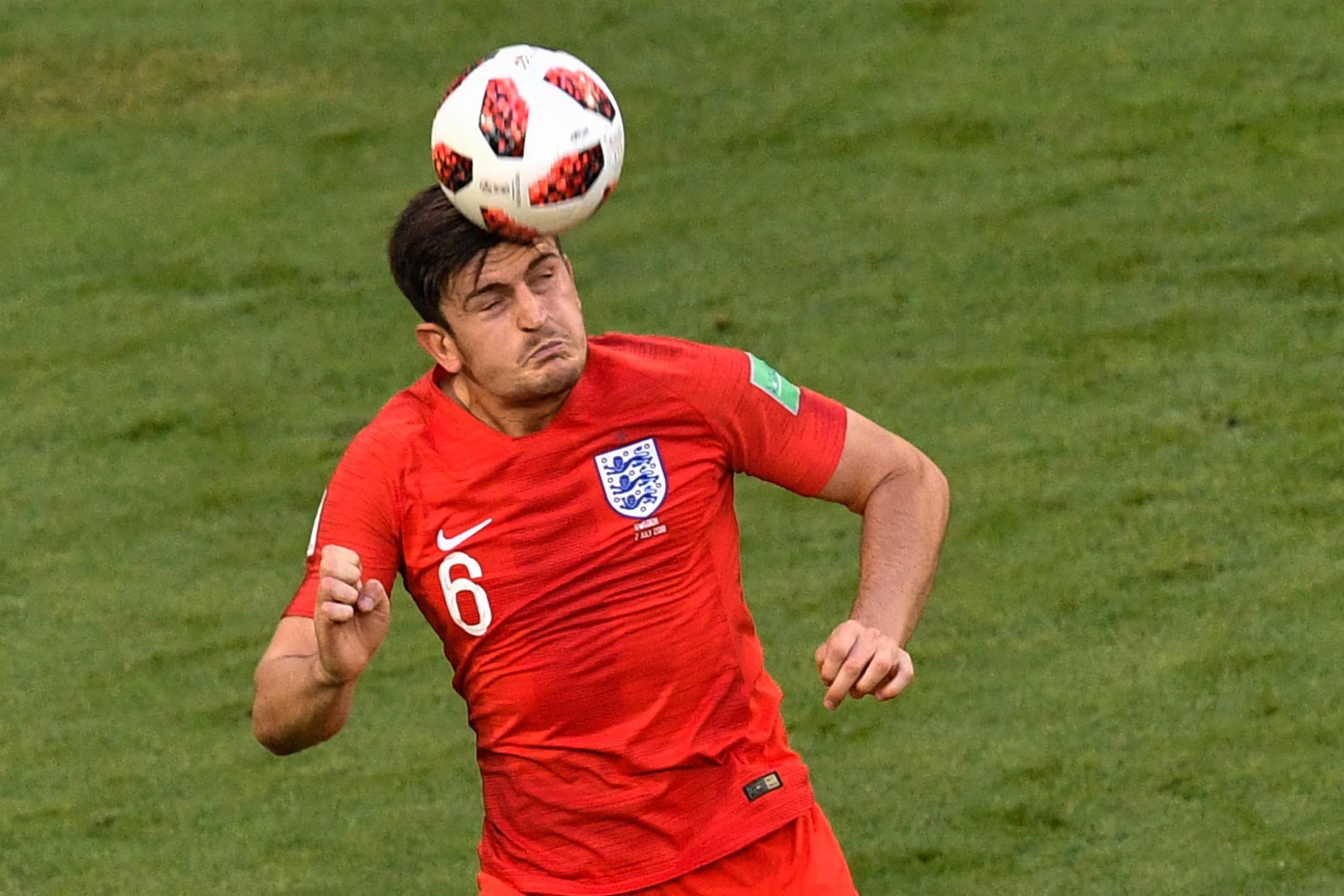 England's Harry Maguire heads the ball