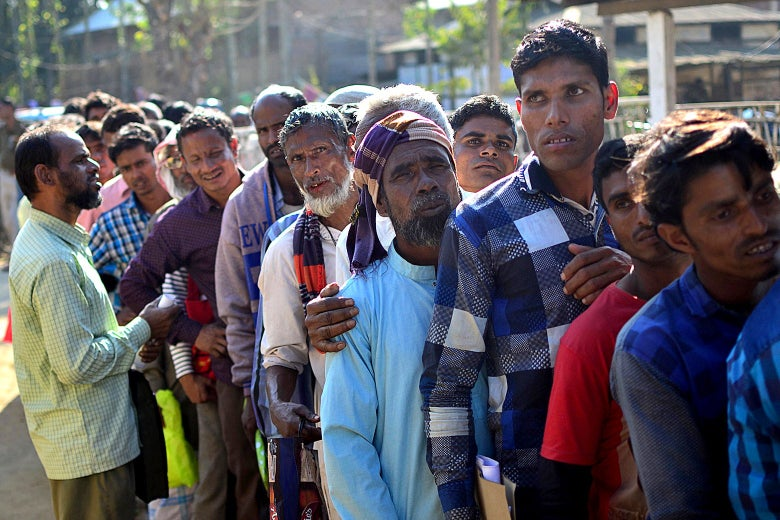 People stand in line to check their names on the first draft of the National Register of Citizens (NRC) at Gumi village of Kamrup district in the Indian state of Assam on Jan. 1, 2018.