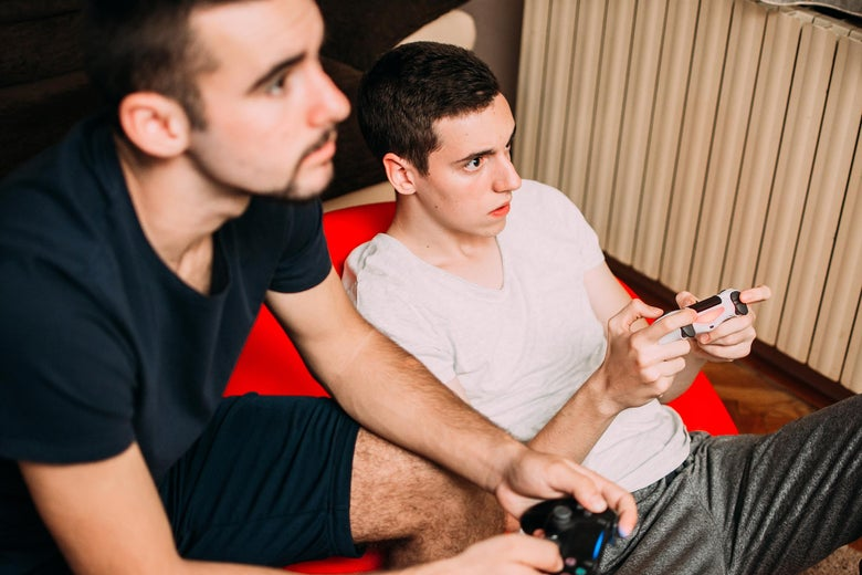 Two young men playing video games.