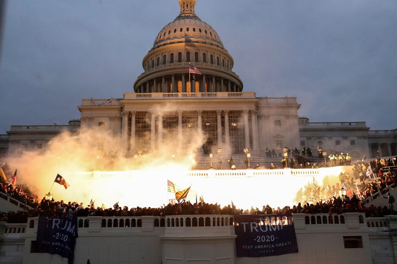 An explosion caused by a police munition is seen while supporters of U.S. President Donald Trump gather in front of the U.S. Capitol building.