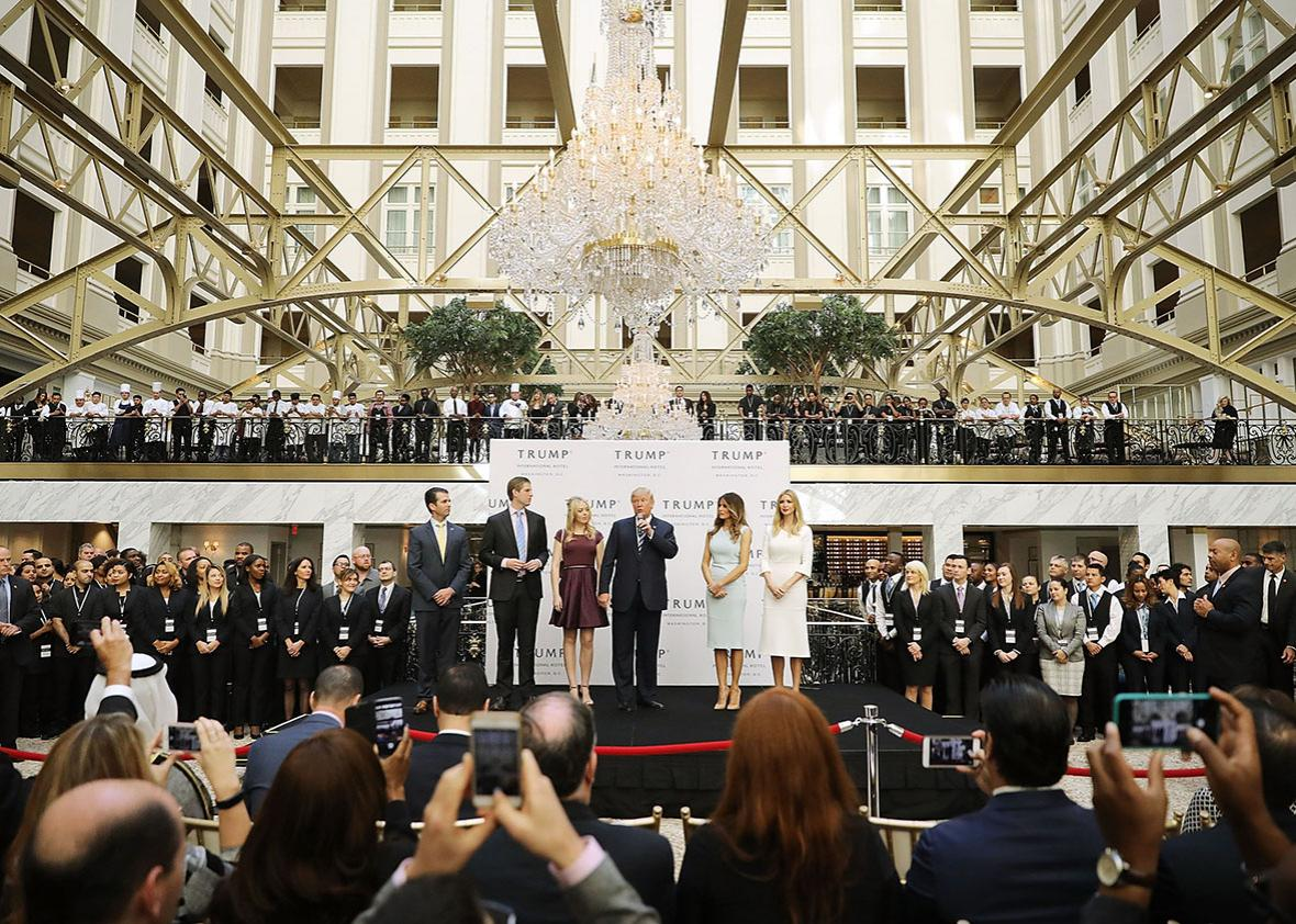 Republican presidential nominee Donald Trump and his family son Donald Trump Jr, son Eric Trump, wife Melania Trump and daughters Tiffany Trump and Ivanka Trump prepare to cut the ribbon at the new Trump International Hotel October 26, 2016 in Washington, DC.