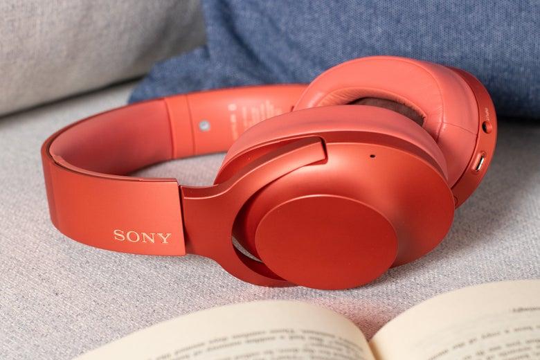 Sony headphones on a cushion near a book