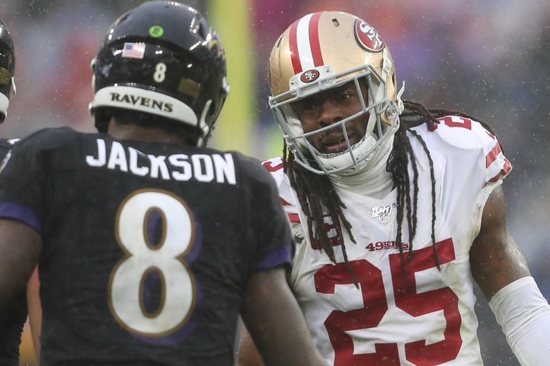 BALTIMORE, MARYLAND - DECEMBER 01: Quarterback Lamar Jackson #8 of the Baltimore Ravens and cornerback Richard Sherman #25 of the San Francisco 49ers talk during the second half at M&T Bank Stadium on December 01, 2019 in Baltimore, Maryland. (Photo by Patrick Smith/Getty Images)