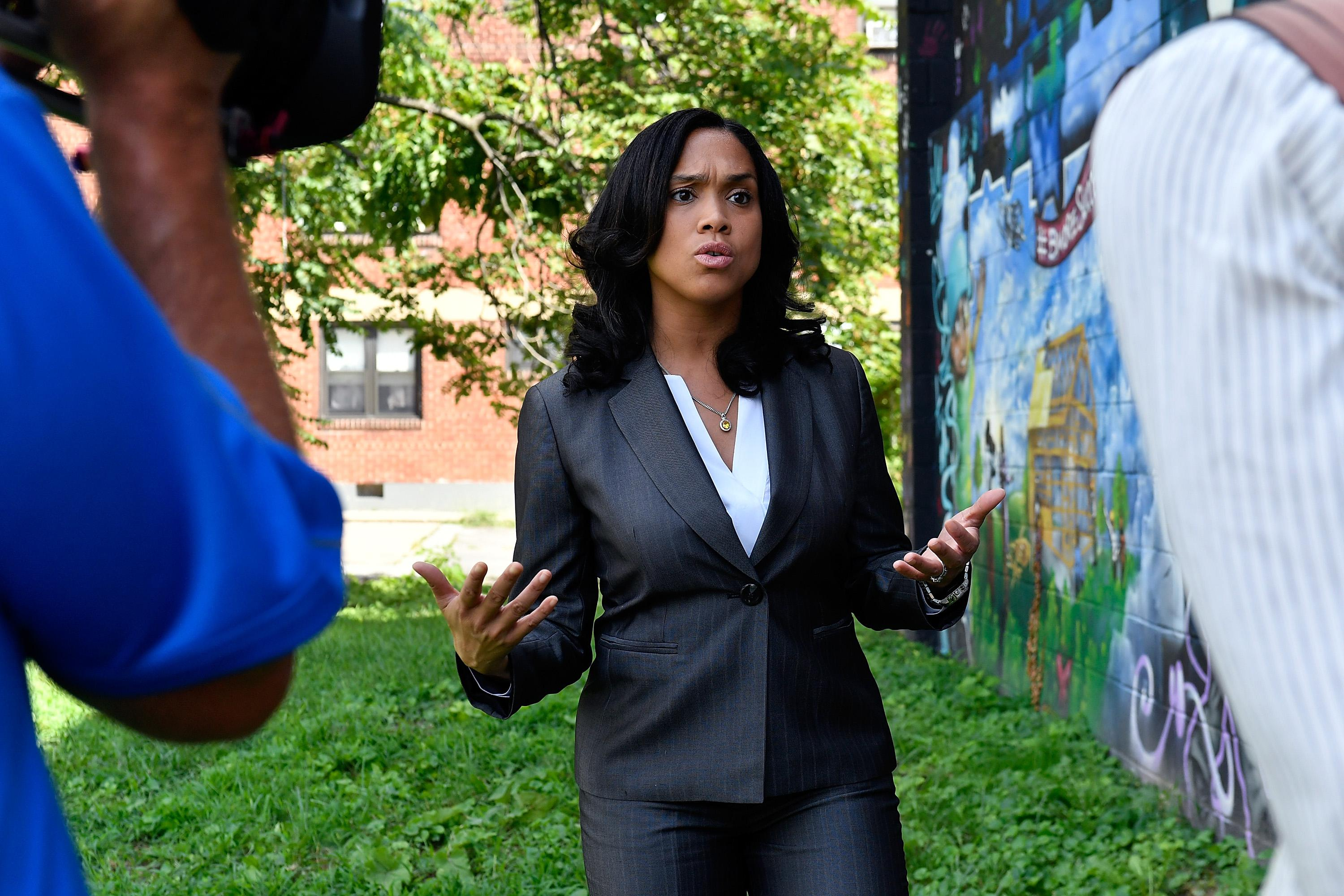 State's Attorney Marilyn Mosby walking through the Sandtown-Winchester neighborhood in Baltimore where Freddie Gray was arrested in 2016.