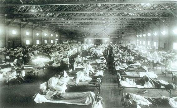 Historical photo of the 1918 Spanish influenza ward at Camp Funston, Kansas.